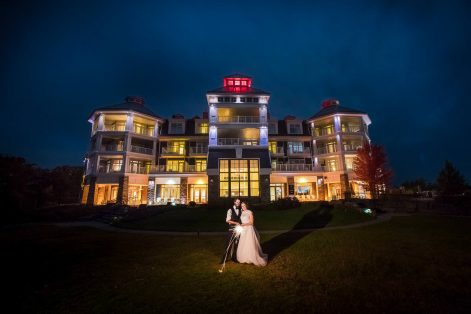 Bride and groom with sparklers at JW Marriott in Muskoka
