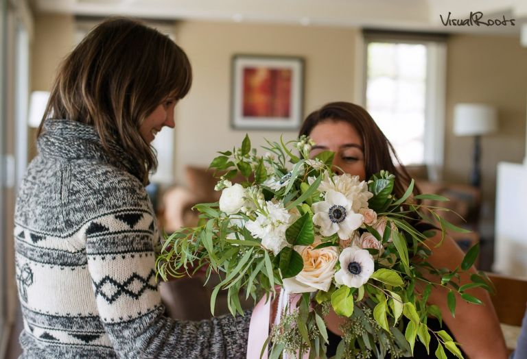 Florist giving flowers to the bride inside
